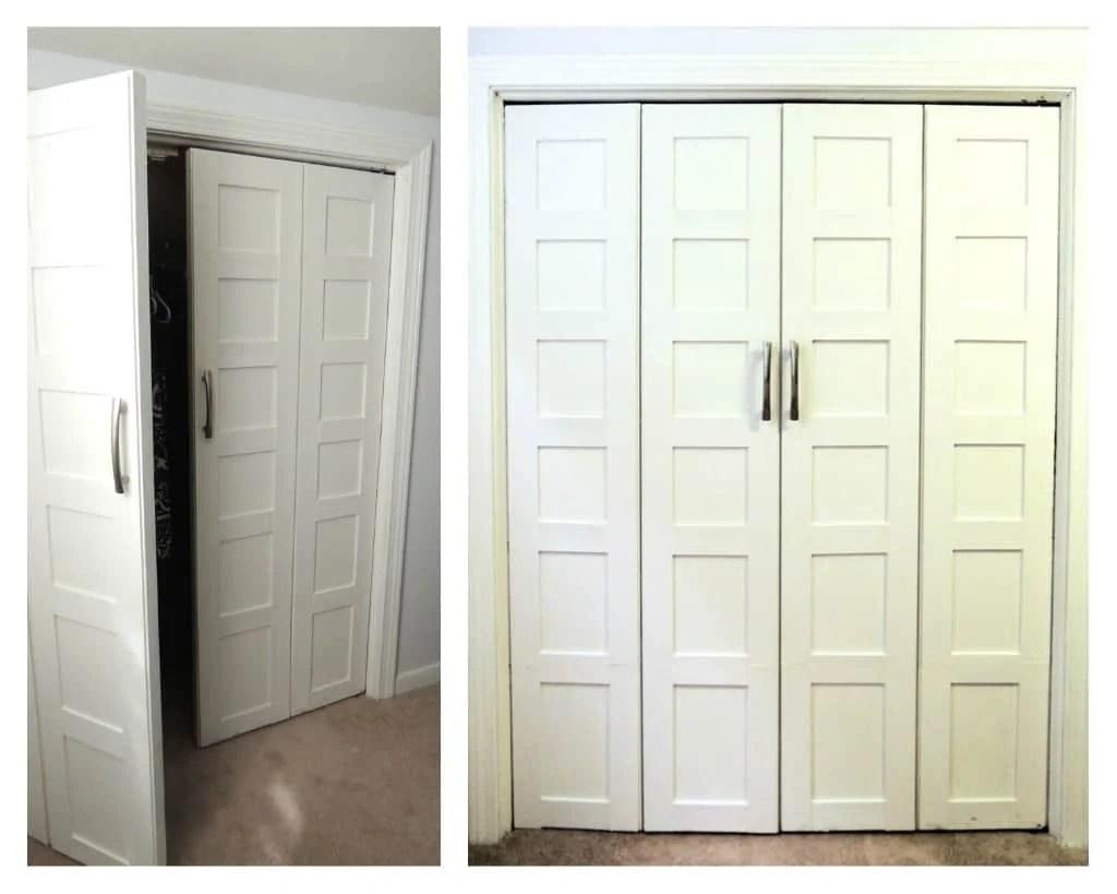 White bedroom closet doors with metal handles