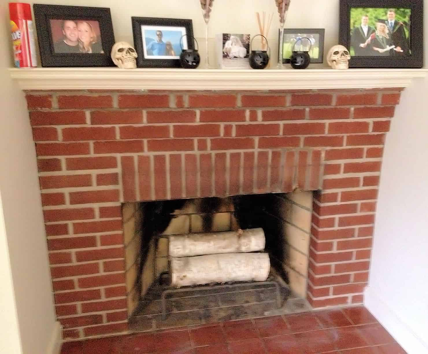 outdated red brick fireplace, before being whitewashed
