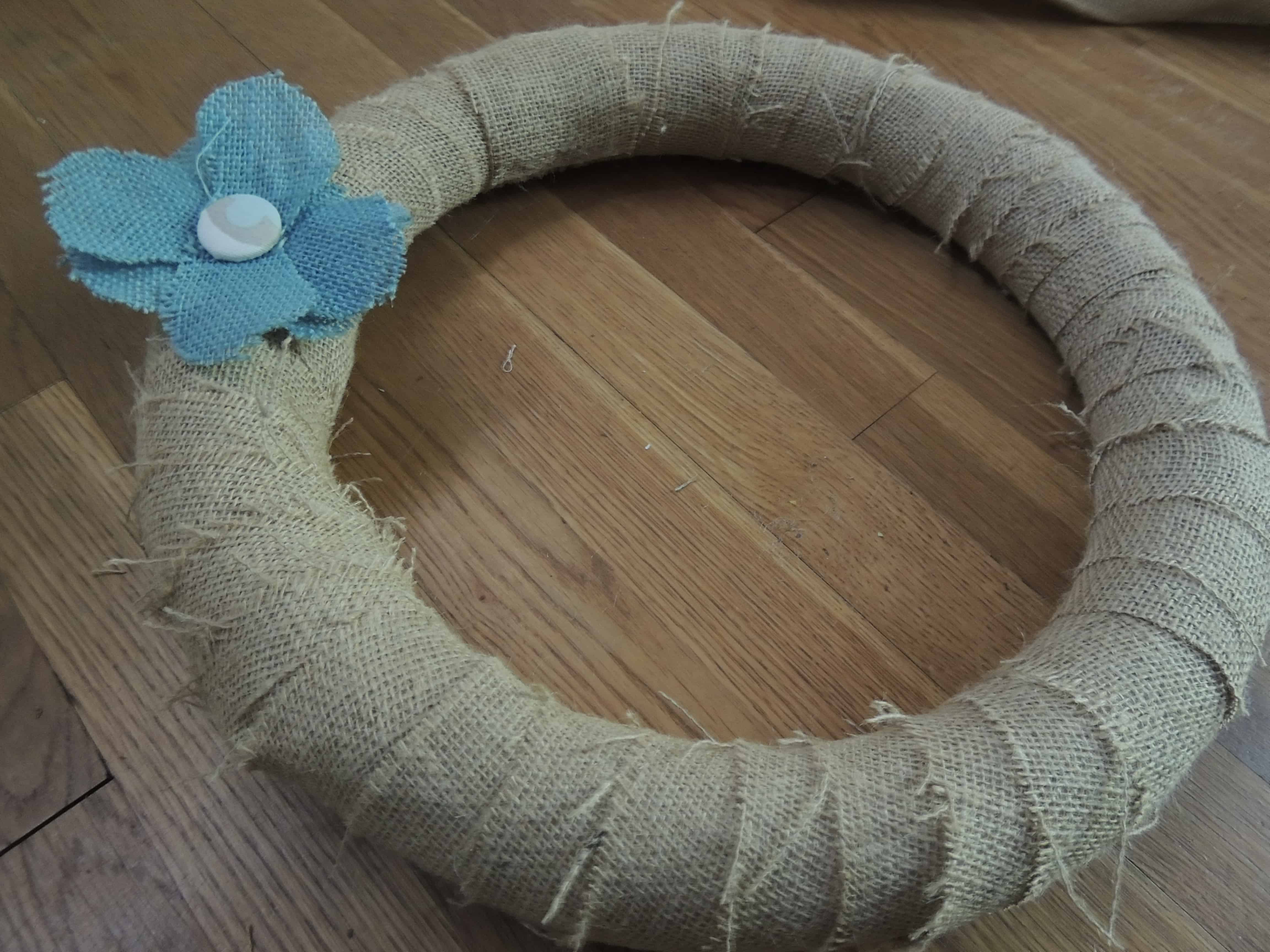 Attach the burlap flowers to the wreath with a few drops of hot glue