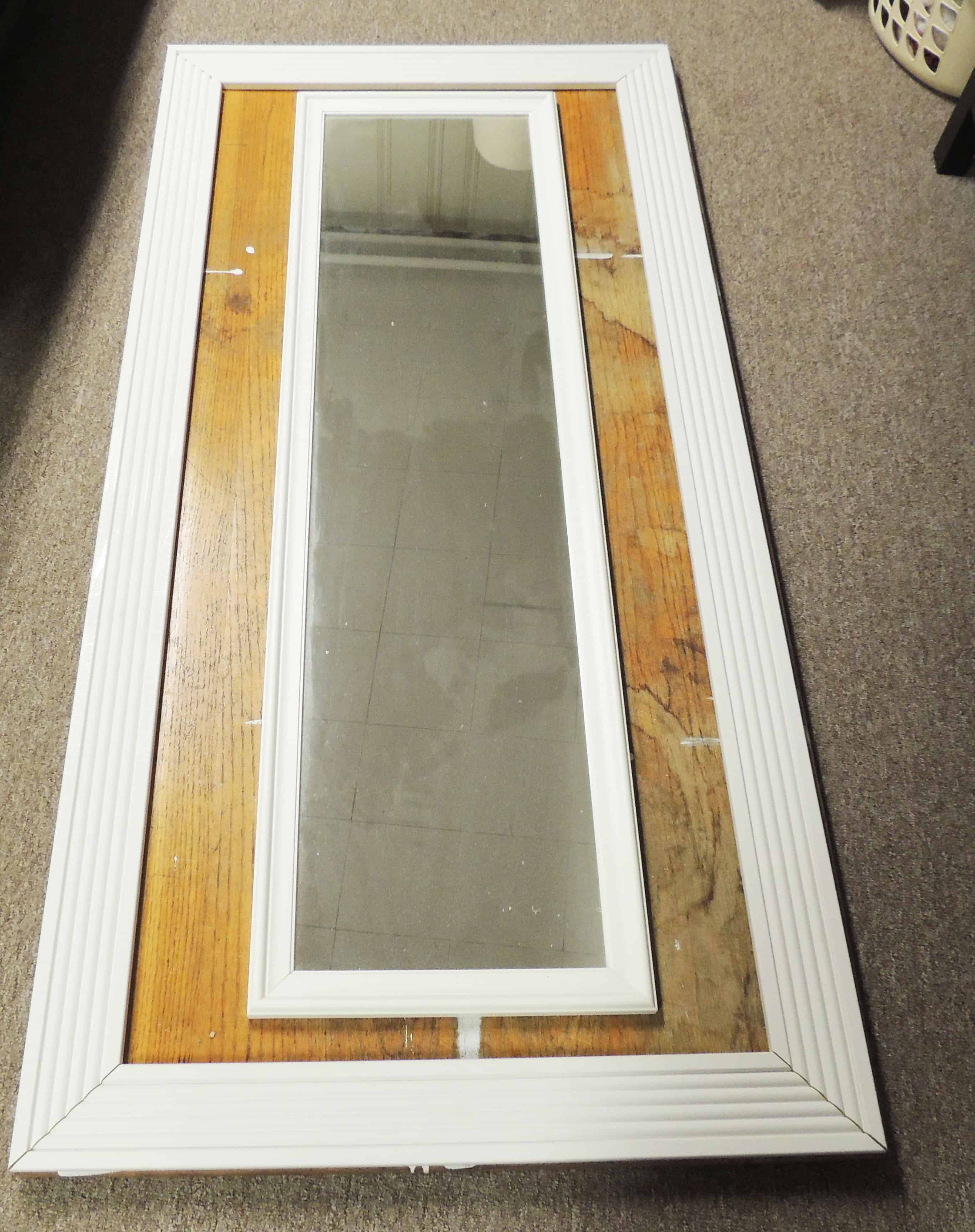 DIY Floor-mirror: $5 mirror set on wooden table with white wooden frame