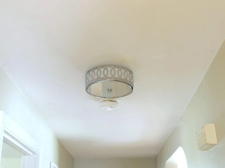 Completed installation of silver light fixture in hallway