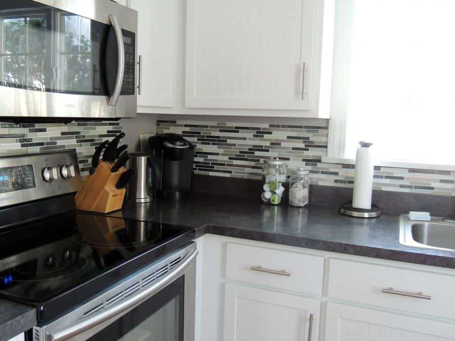 Here is a look at the peel and stick kitchen backsplash almost entirely installed around my kitchen counters!