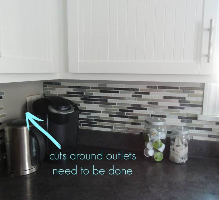 Installing this peel and stick backsplash was crazy simple, until we got to the wall outlets!