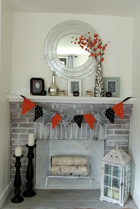 Our Halloween mantel includes framed chalkboard printables to add a spooky touch
