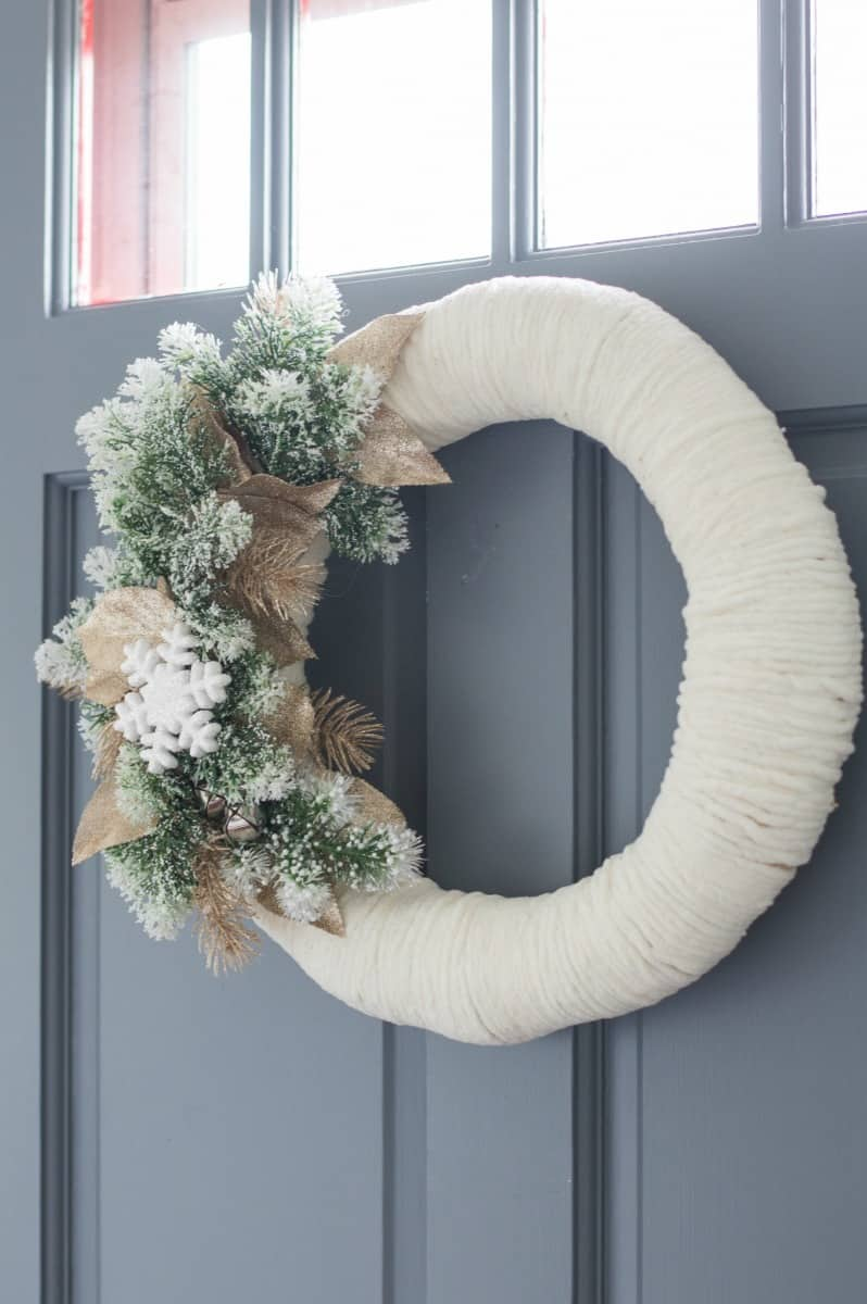 Welcome guest to your home with this simple DIY winter wreath on your front door