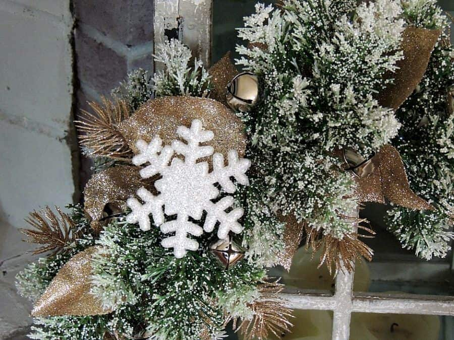 I used snowflake ornaments and snow-dusted leaves and pine branches as accent pieces on my winter wreath