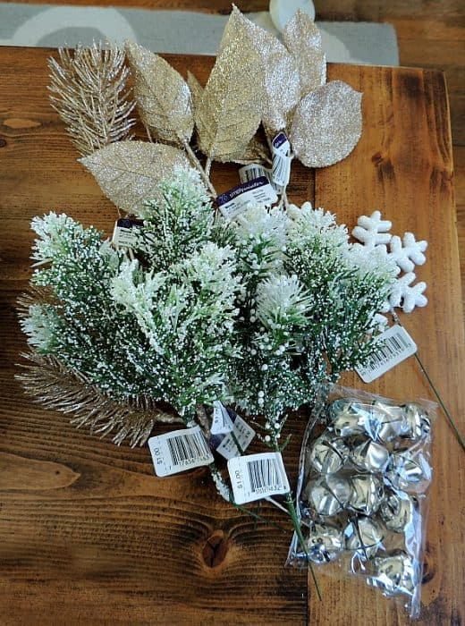 Decorate your winter wreath with festive accent pieces like snow-covered pine branches, snowflake ornaments, and bells