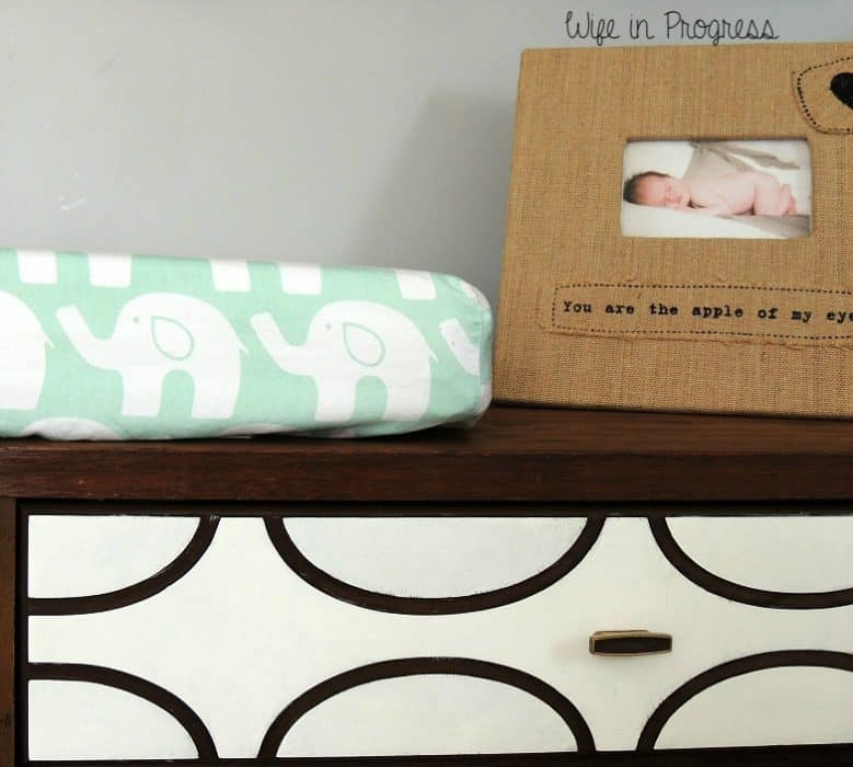 We gave this old dresser a makeover to match the fabric patterns in our baby boy's nursery