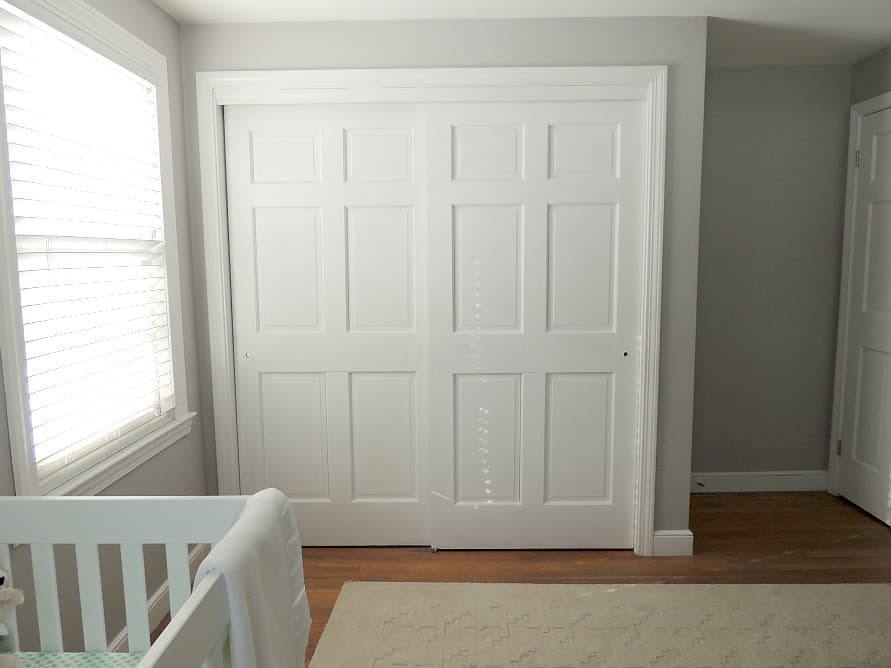 We kept the walls and closet door of our baby boy nursery white so we could decorate with more colorful fabrics