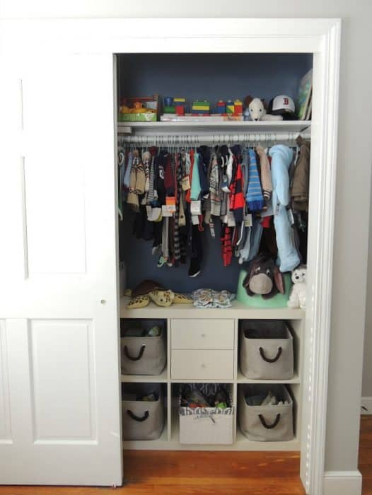 The closet in our baby boy's nursery was organized by clothing size with cubbies for other essentials