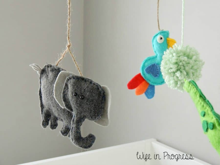 Our baby boy's nursery crib mobile has a little baby elephant and bird