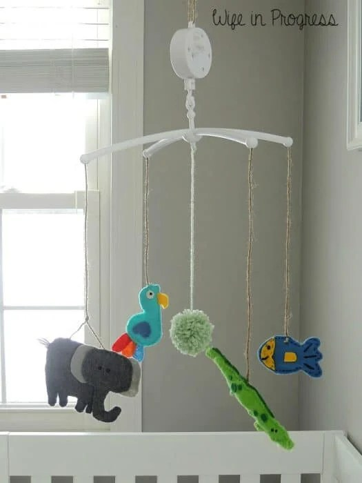 You can easily DIY a baby crib mobile with little felt baby animals like this one