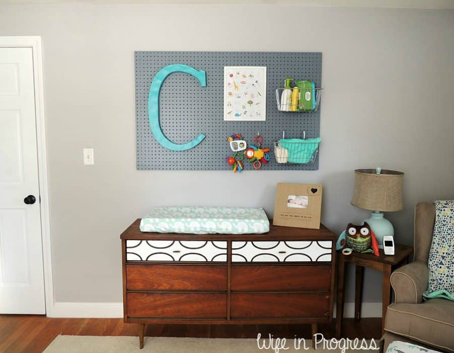 We added a pegboard to the wall in our baby boy nursery to help with organization in the changing area