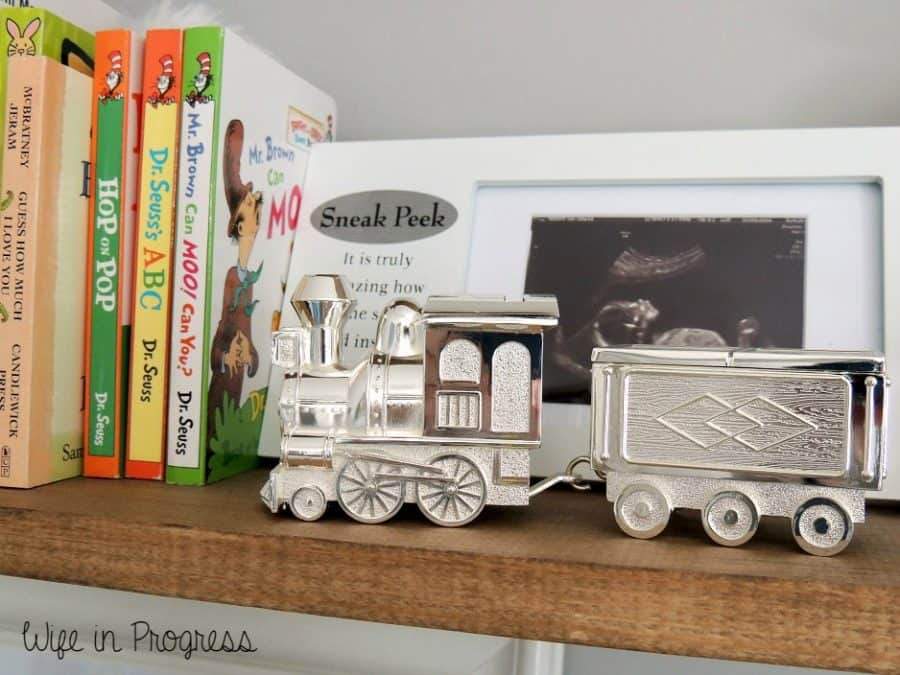 We decorated our baby boy nursery with vintage baby toys like this silver train