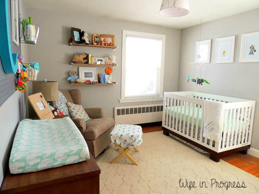 We kept our baby boy nursery nice and simple, with light colors like teal, blue, and light gray