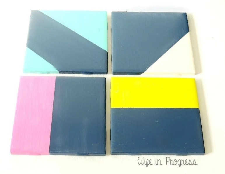 DIY painted tile coasters featuring geometric designs
