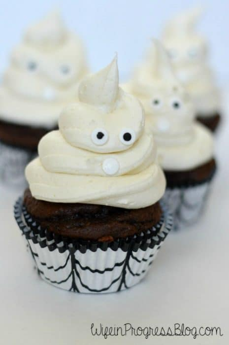 Edible pearls make the eyes and mouth of these spooky Halloween ghost cupcakes