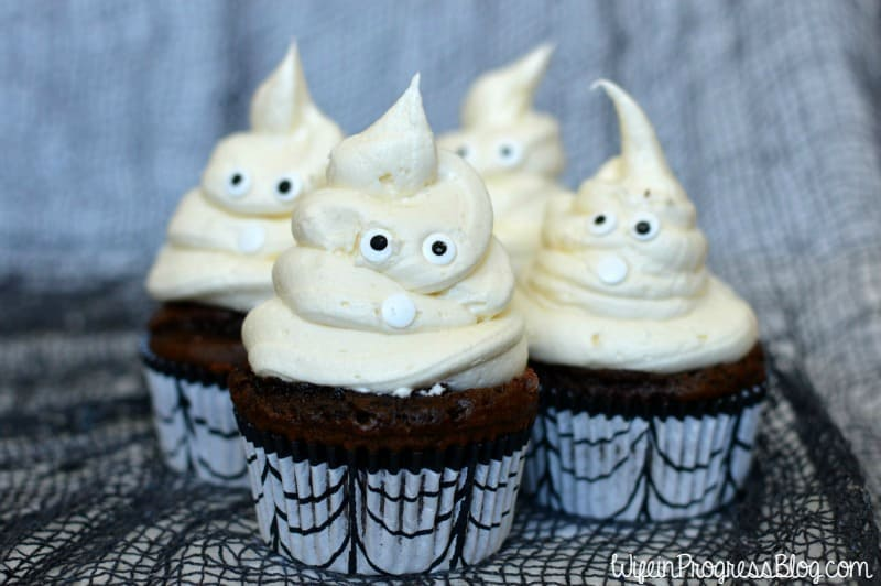 Pipe the vanilla icing onto your chocolate cupcakes in a swirl to make a spooky ghost form