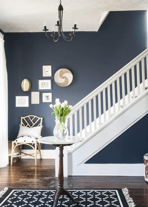 Naval entryway with white staircase