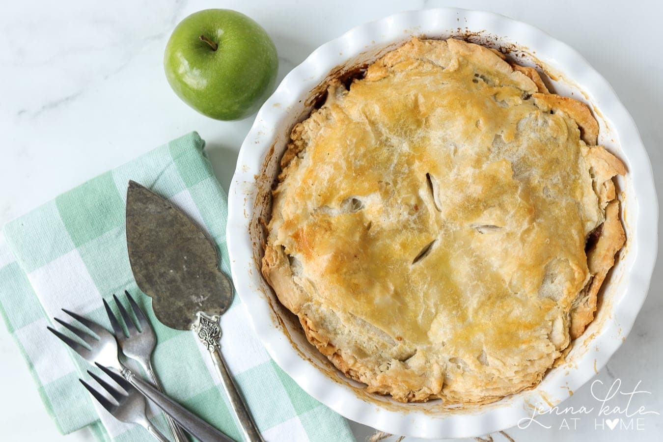 flaky apple pie in a pie dish
