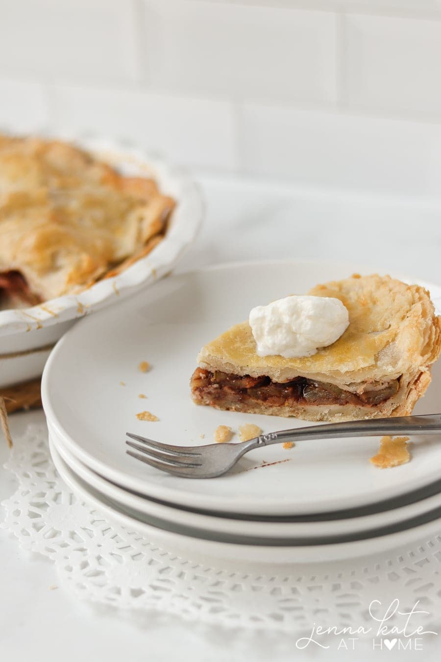 slice of pie on a plate with whipped cream on top