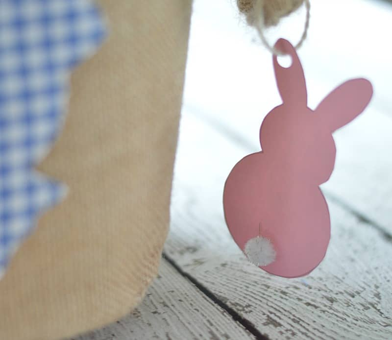 Pink paper Easter bunny with small white pom pom tail