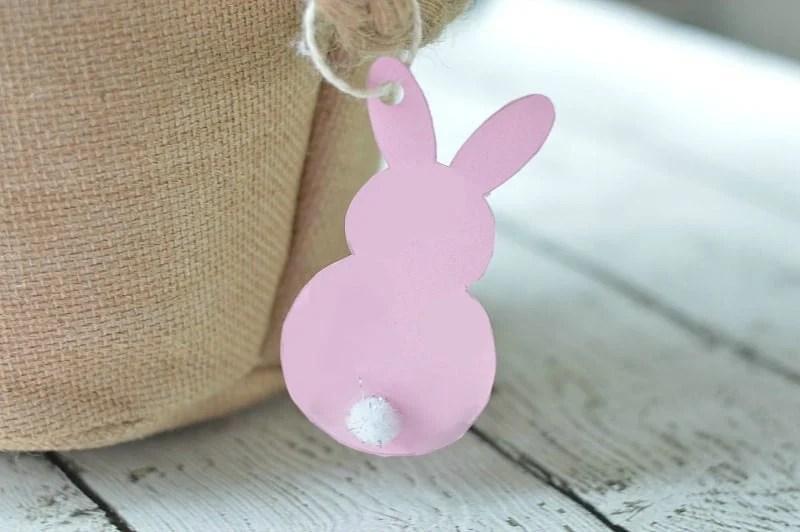 cardboard bunny gift tag hanging off an Easter basket