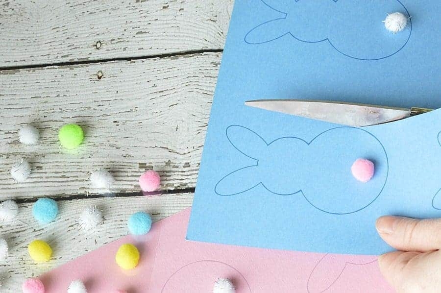 Cutting out the Easter bunny templates with a scissors
