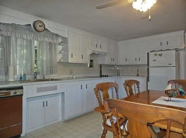 A old fashioned kitchen with a dining room table