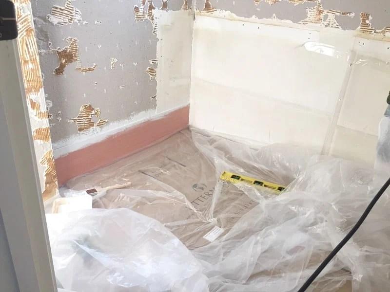 Installing plywood shiplap on the bathroom wall