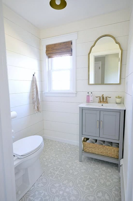 powder room with shiplap and cement tile floors