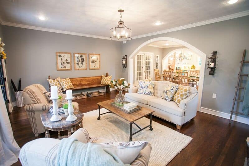 Neutral couch in a fixer upper style living room