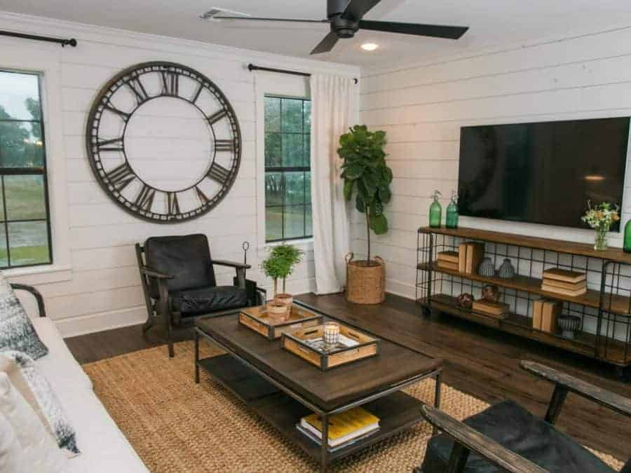 Fixer Upper living room with large clock, industrial furniture and shiplap walls