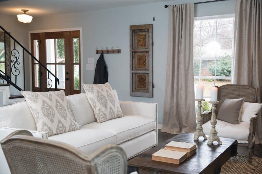 Blue Gray walls and off white couch in the farmhouse style living room