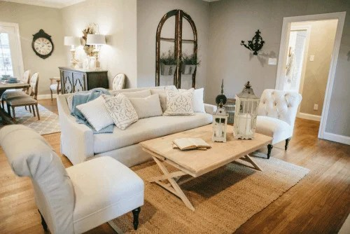 Joanna Gaines designed living room with neutral couch and light wood furniture