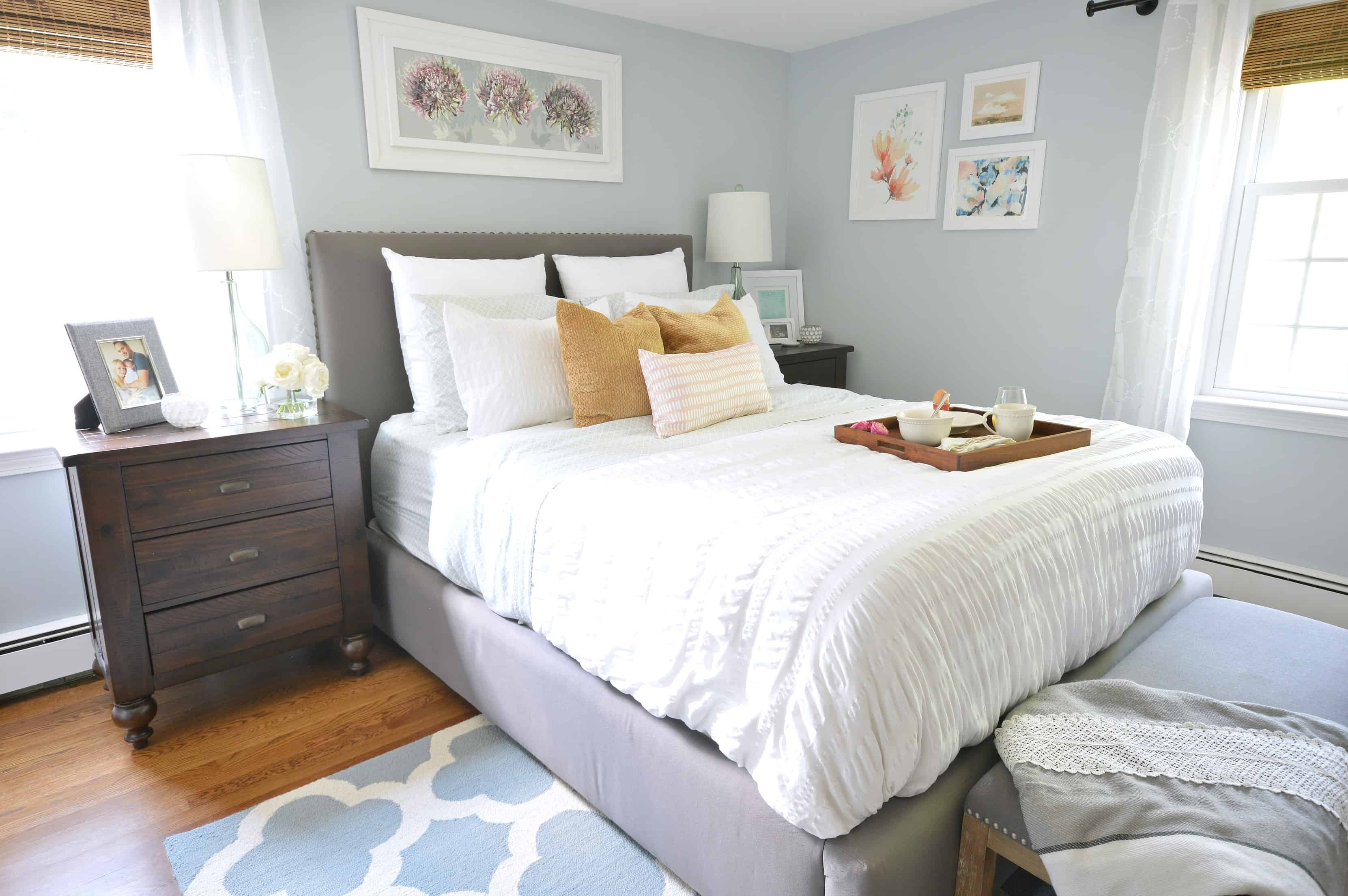 Grey bedroom - Take a tour of this stunning gray master bedroom. Featuring pops of color and lots of texture. You won't believe the before pictures! Full source list included so that you can recreate the look.