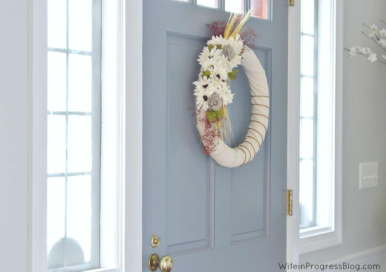 Fall wreath hanging inside front door