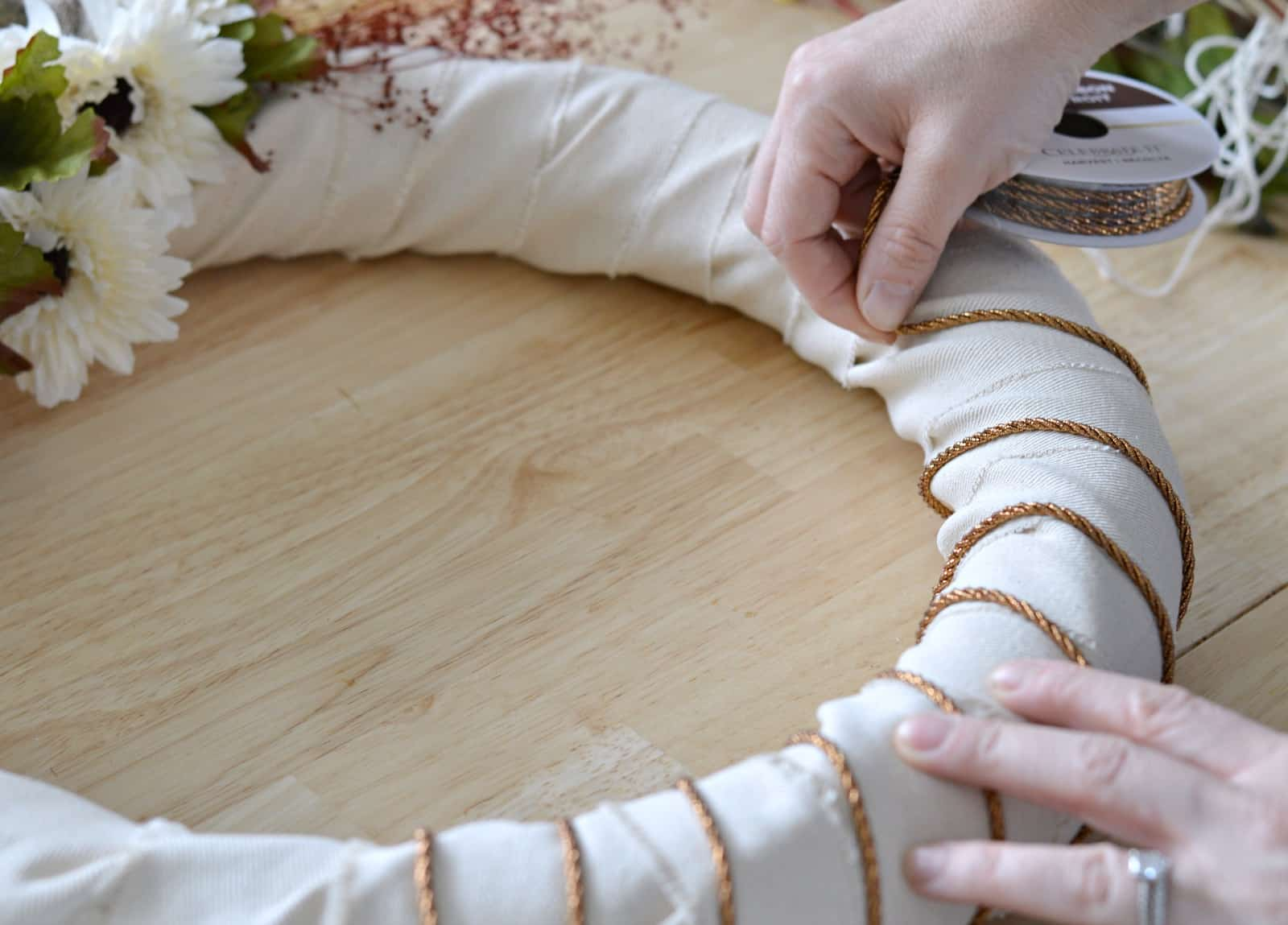 wrapping copper string around the wreath