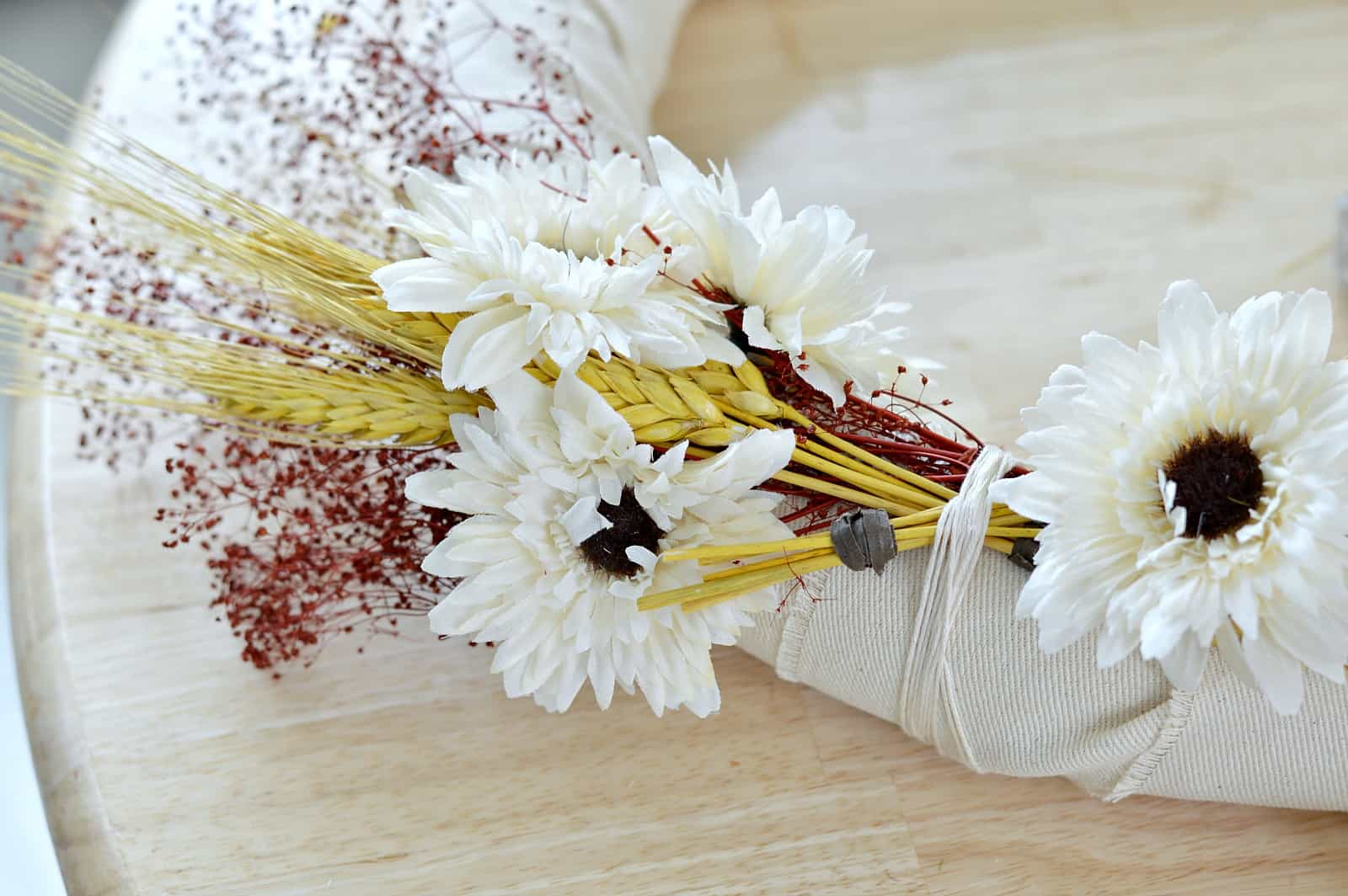 tie wheat to the wreath using twine or string