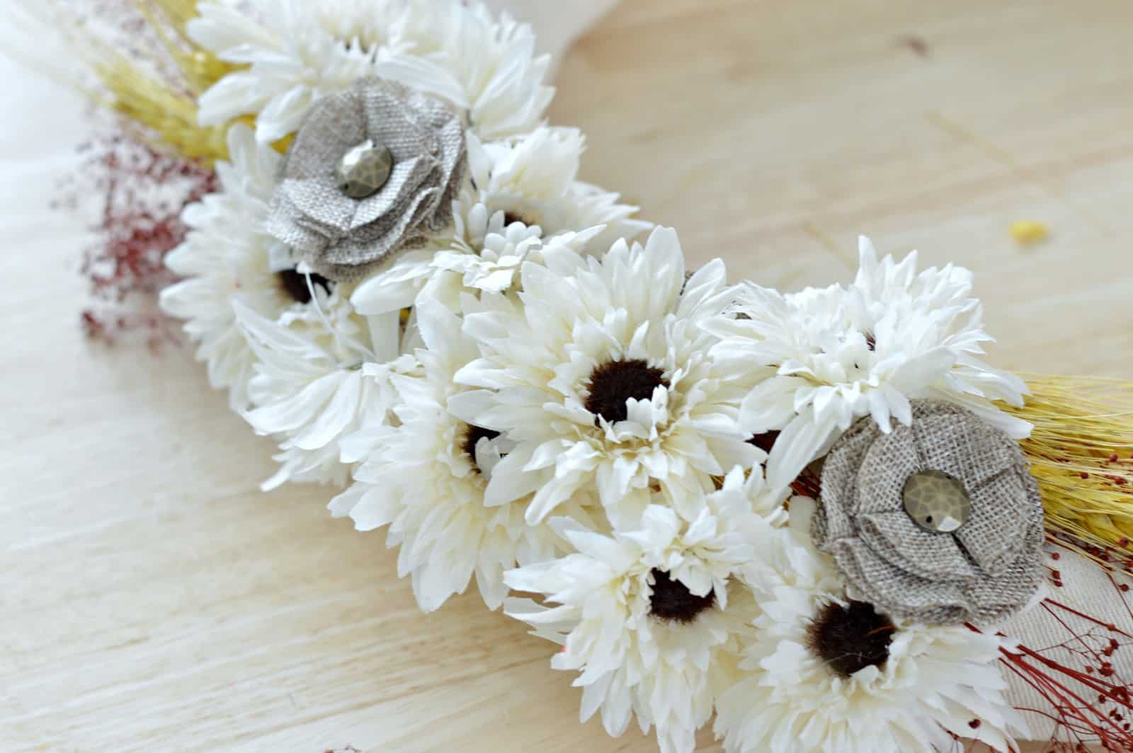 close up of faux flowers glued to the fall wreath
