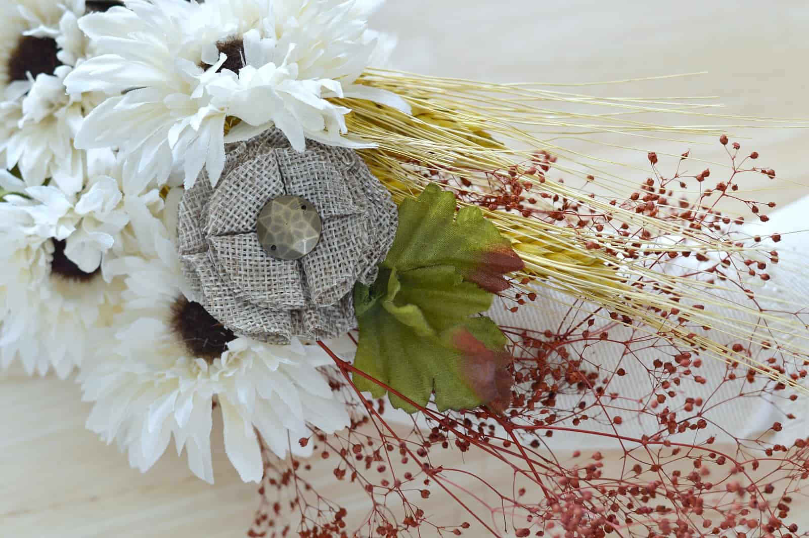 close up of the burlap flower attached to the wreath