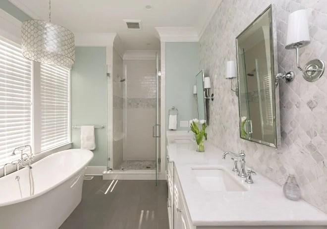 Elegant bathroom painted a soft gray green paint color
