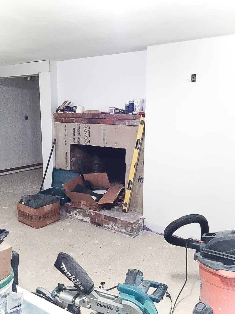 basement-reno-week-3-marble-fireplace-6
