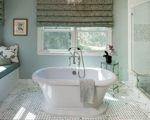 Bathroom with large soaking tub in the middle and walls painted Quiet Moments