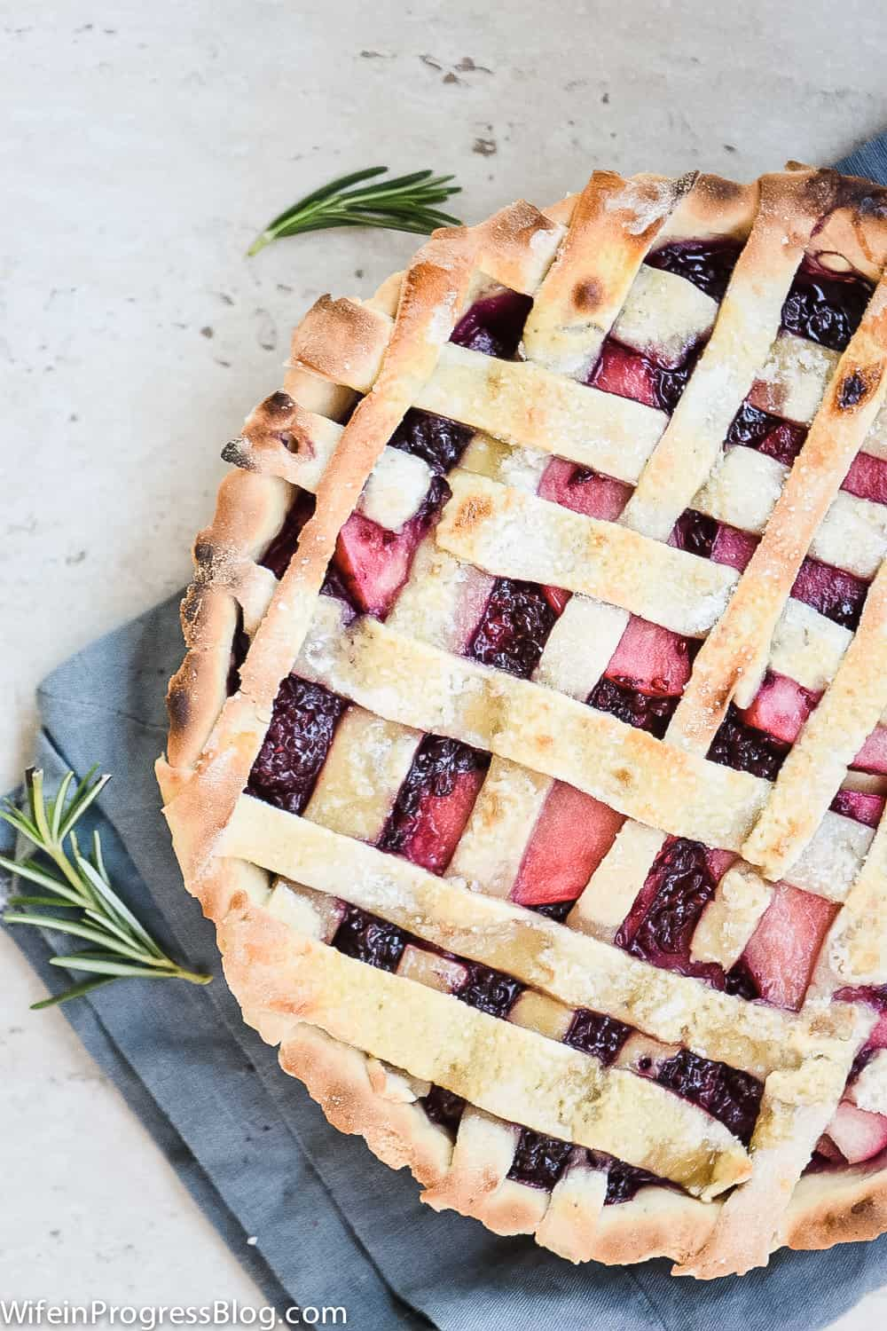 close up of the filling and lattice on the blackberry apple pie