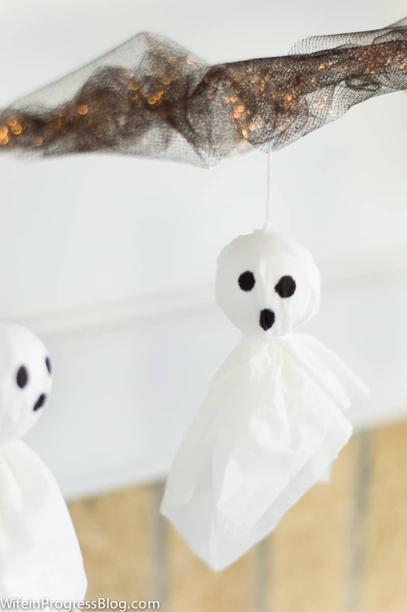Make a simple Halloween ghost garland with tissue paper and foam balls