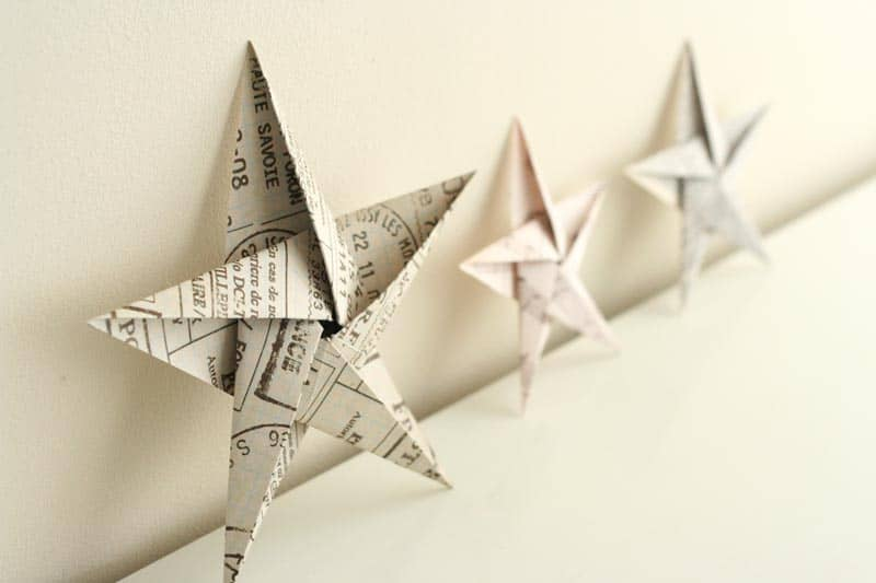 You can make these origami Christmas star ornaments with anything from craft paper to book pages or newspaper