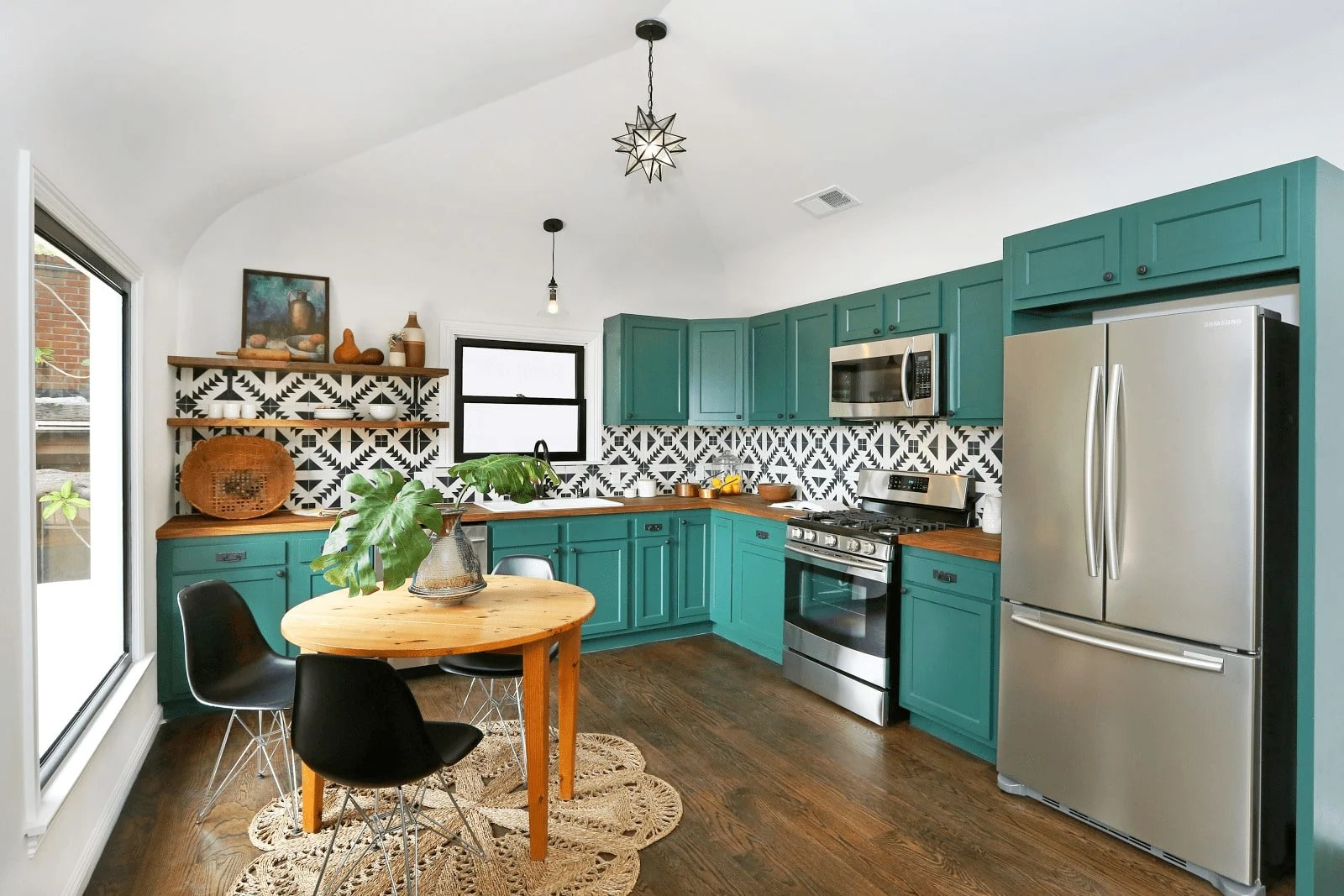 Trendy kitchen with green cabinets