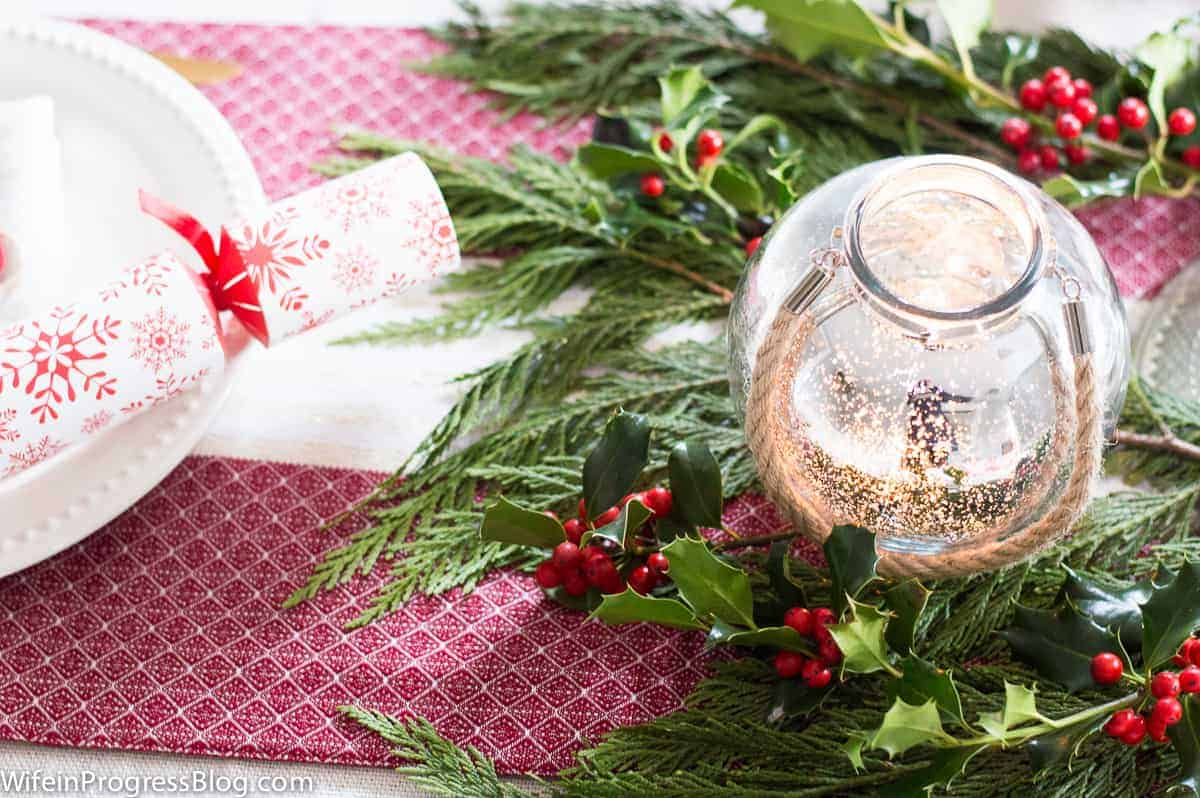 Christmas table decorations don't have to break the budget - a little holly and some mercury glass adds instant festiveness!