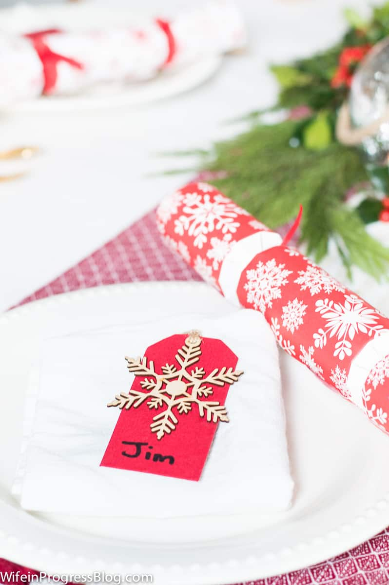 Be creative with your Christmas table decorations. Instead of expensive napkin holders and fancy name tags, use gift tags!